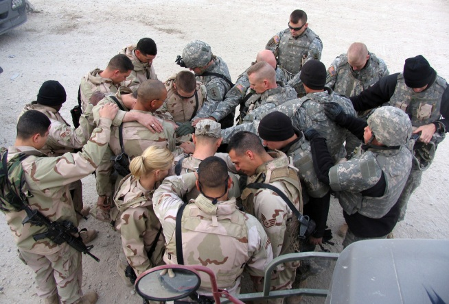 U.S. Soldiers in prayer