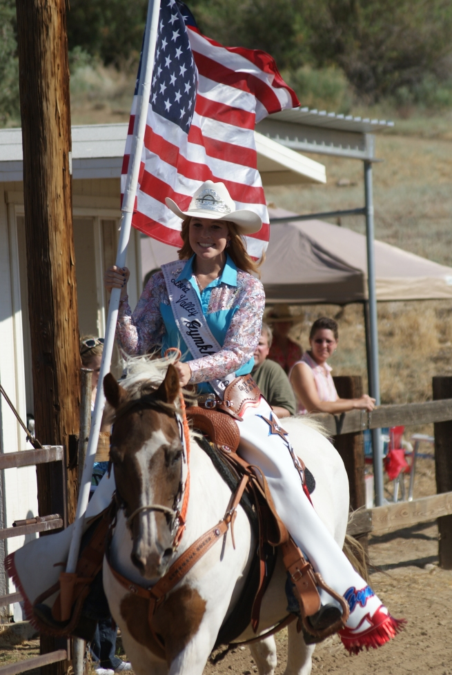Carlene is the current Leona Vally Gymkahna queen and all of this hit her about two months after winning the crown, here she is just two weeks ago running the American flag for the opening of the Leona Valley Gymkahna wearing her wiglet and hat and hoping it all doesn't blow off during the run!!!!