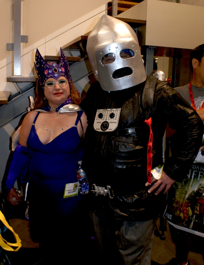 one of the costumed couples at the show with an incredible Commando Cody outfit and jetpack