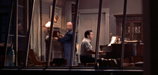 a still of Hitch's cameo, he is seen winding a clock in the piano players apartment