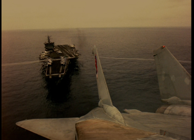 the greatest shot in the world. the tail mounted camera as the F-14 launches from the deck and rolls into battle