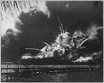 The USS SHAW explodes during the Japanese raid on Pearl Harbor,Hawaii