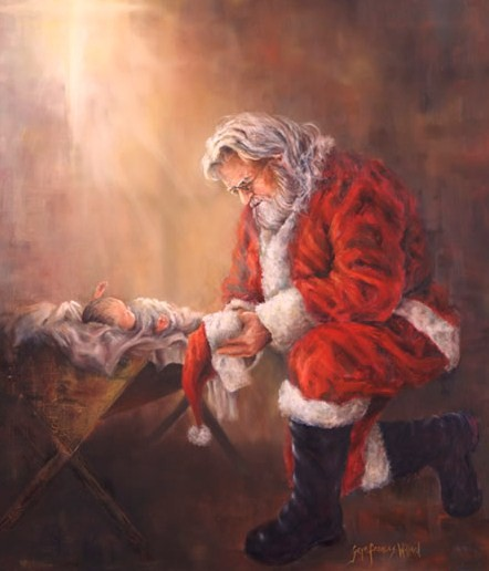 Santa praying to newborn Jesus